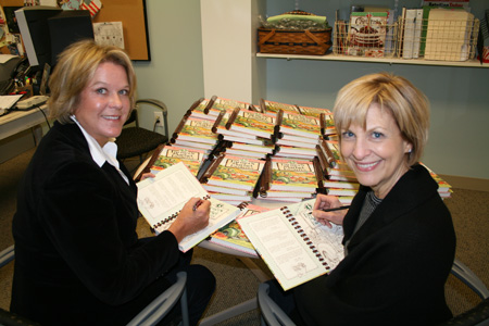 Signing all those books!