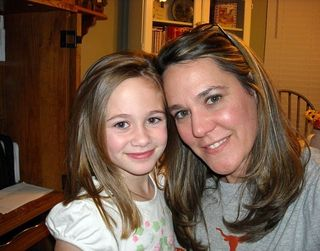 Tina and daugher MacKenzie...and one of our cookbooks in the background!