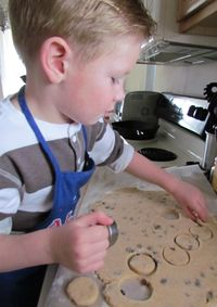 Alex making Cinnamon Raisin Biscuits
