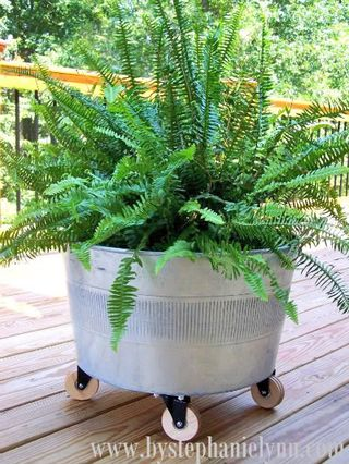 Rolling Galvanized Tub by By Stephanie Lynn | Featured in Clever Container Garden idea slideshow by Gooseberry Patch